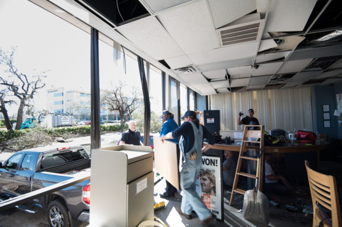 Volunteers help clean out the KNON studio after a tornado reduced it to rubble. Photo by Jordan Jarrett